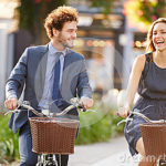 biking businesswoman-businessman-riding-bike-city-park-close-up-smiling-40096921
